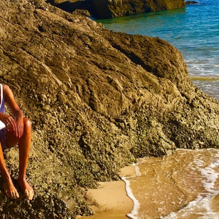solo female traveler alone on beach