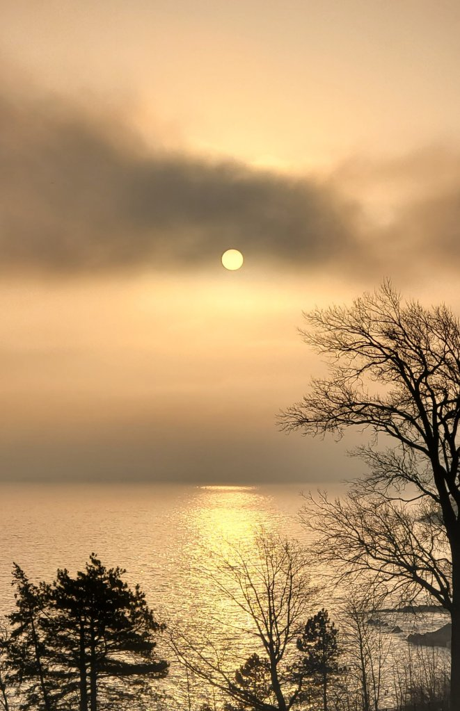 Hazy morning sun over the lake.